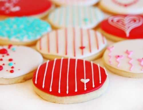 cute decorations on valentines cookies. i like the striped ones with the little hearts