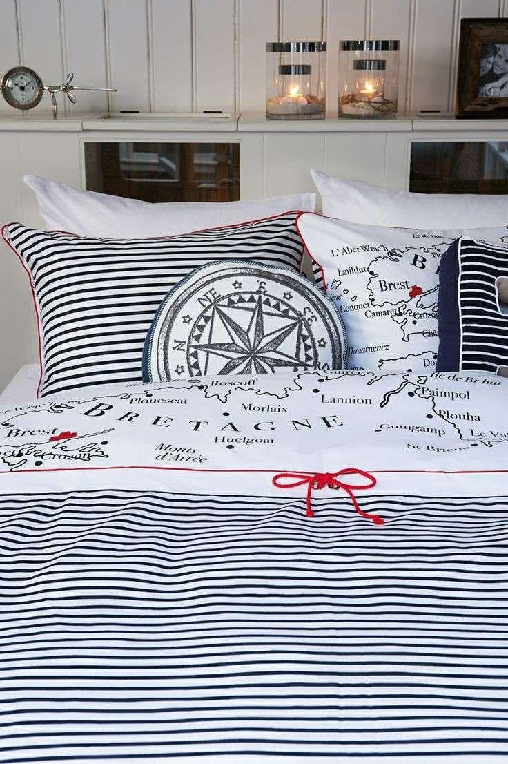 Camera da letto stile marina - Cuscini e lenzuola in stile nautico