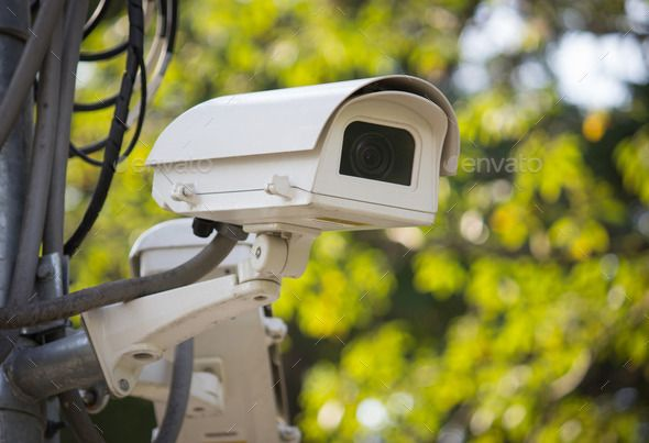 Security surveillance camera in the park. http://photodune.net/item/security-surveillance-camera-in-the-park/10059788