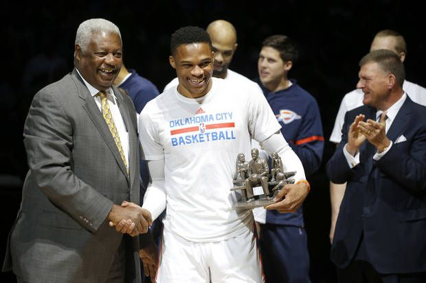 Oscar Robertson shakes hands with Russell Westbrook as Westbrook is honored before an NBA basketball game between the Oklahoma City Thunder and the Denver Nuggets at Chesapeake Energy Arena in Oklahoma City, Wednesday, April 12, 2017. Photo by Bryan Terry, The Oklahoman