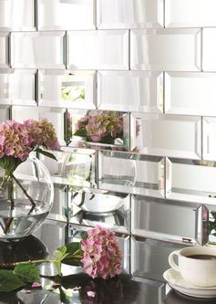 Mirror bevelled brick tiles. Perfect for a dressing room or small cloakroom