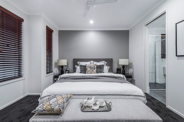 #Bedroom #design #ideas from #Ausbuild's Allendale #display #home. www.ausbuild.com.au. This #master #bedroom #features an impressive #walk-in #robe and #en-suite with a stunning grey back #wall.