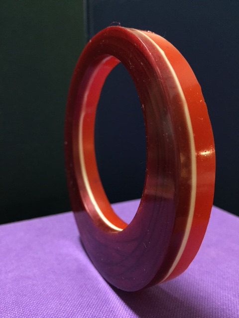 Hand made resin bangle tinted red, white and orange with an iridescent swirl on one side by TheFlightyFlamingo on Etsy