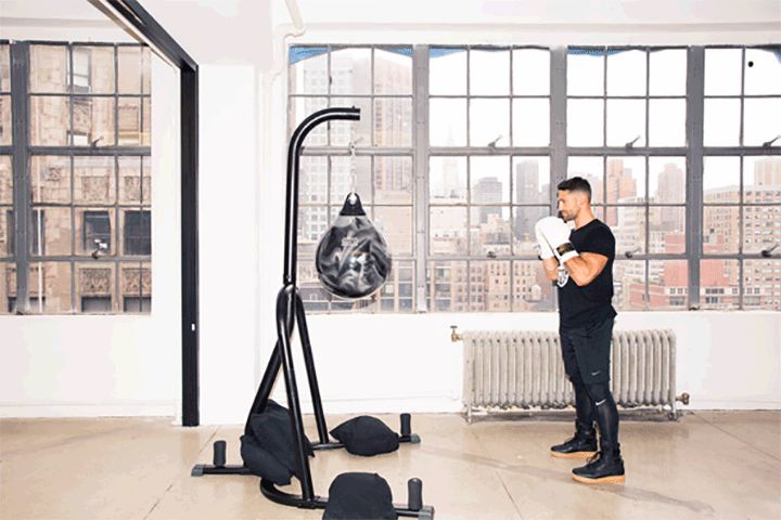 Rumble's Co-Founder Shares a Boxing Workout for Your Butt: Boxing is more than punching and ducking (and imagining your ex's face on a bag). It can also be one hell of a lower-body workout. Don't believe us? Just try the 10 butt-lifting combos that Noah Neiman, the trainer and co-founder of Rumble (NYC's newest, you guessed it, boxing studio), created just for us.—How to do a jump switch lunge. | coveteur.com