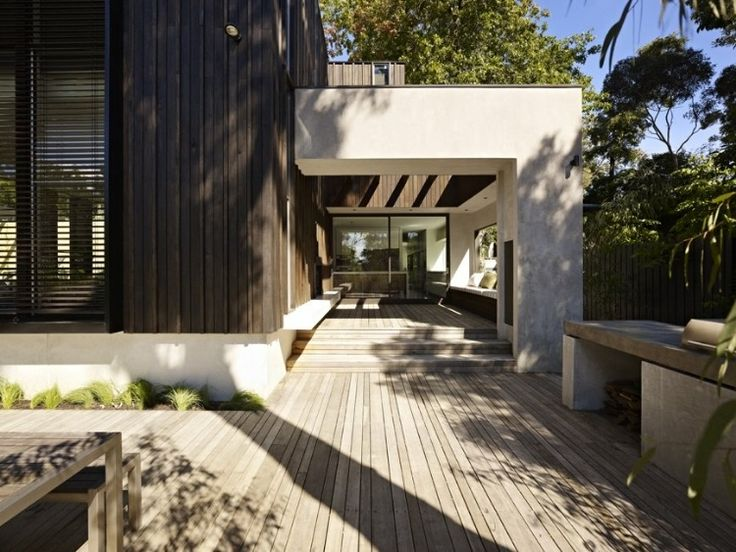 Epic, perfect deck area. Adore the different widths of the deck timber and the large concrete (?) roof frame going out over the deck. The Avenue by Neil Architecture