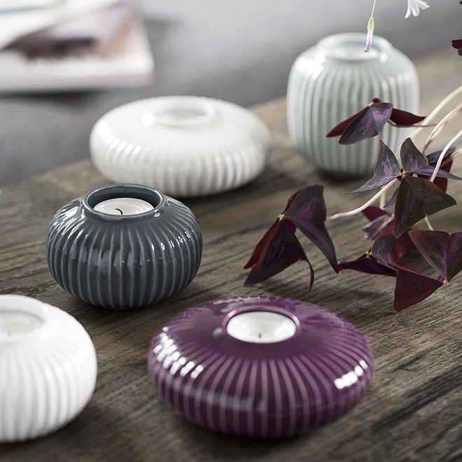 Use the elegant, Hammershøi tealight holders to create an exciting contrast to an otherwise monochrome Scandinavian interior. The small tealight holder is created with the historical furrows, which characterise the entire Hammershøi range. The furrows let the plum glaze spread lightly and elegantly over the surface in the most beautiful way.