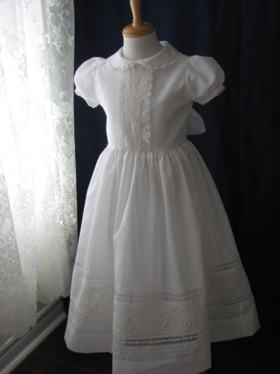 Exquisite heirloom communion dress. Lavished with fine hand embroidered white work. leaves and floral design executed with open thread work,