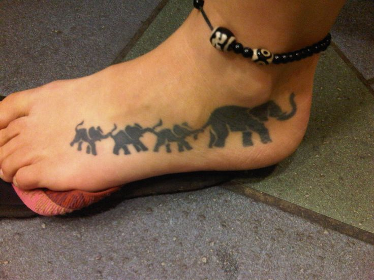 This tattoo was inspired by the women's 3 children. Elephants. Follow the leader. Trunk to tail. More