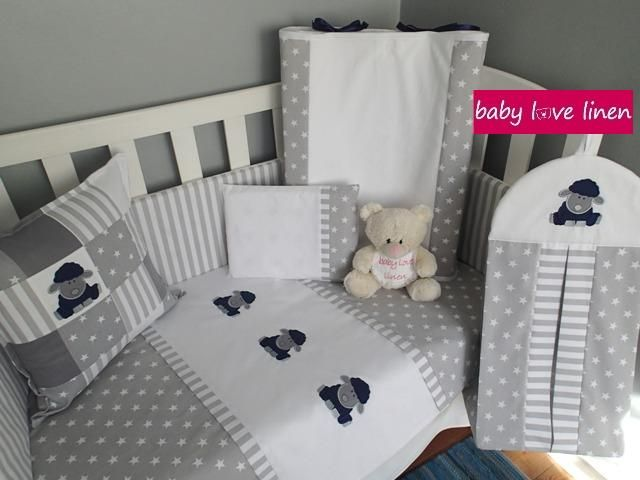 Lamb-themed full cot set.