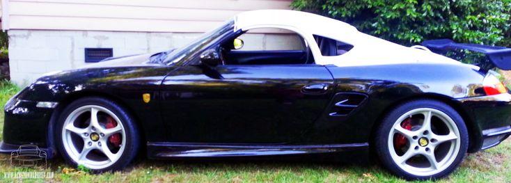 Black Porsche Boxster with unpainted hardtop.