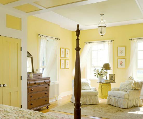 Despite its reputation as an energetic color, yellow can be conducive to quiet relaxation. This pale buttery wall shade has pastel notes that keep it on the serene side of the color equation. Traditionally-inspired slipcovers, bedding, and rug in maize and ivory contribute to the serene atmosphere./