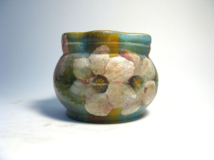 flowerpot with hand-painted decoration of flowers, possibly the native hibiscus