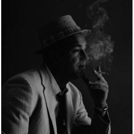 Posterazzi Studio portrait of man wearing hat smoking cigarette Canvas Art - (24 x 36)