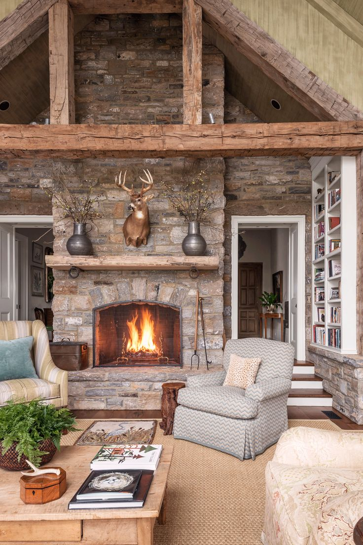 Light filters in from three sides of this living room, which is filled with stone and wood elements.