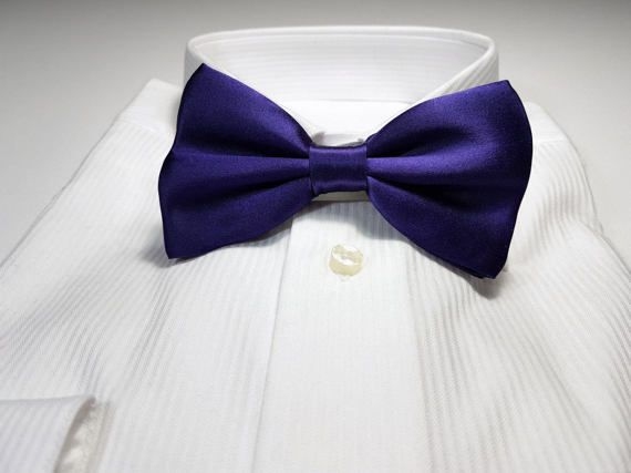Current Promotions: https://www.etsy.com/ca/shop/joyneckwear?section_id=12630800  ----------------------------------------------------------------------------------------------------  -------------------------------------------------------- Coordinates with: REGENCY of Davids Bridal The bow tie is a shade darker than the dress color --------------------------------------------------------  Large Dark REGENCY Purple SILK Bow Tie with Gift Box Pre-tied with hook ar...