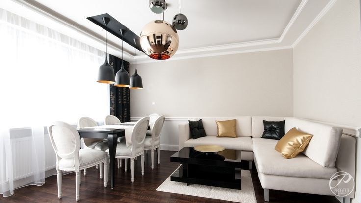 Apartament w Łomiankach  Salon połączony z jadalnią. Designerskie lampy. Progetti Architektura