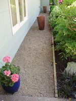 Like to use gravel in the front for the mail delivery - camoflage it with shrubs.