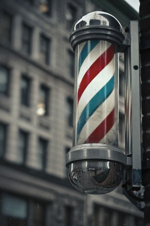 A traditional barber pole. The colours represent the aspects of a barber.