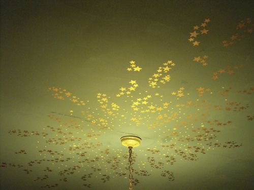 Sweet, romantic celestial ceiling with shimmery gold stars