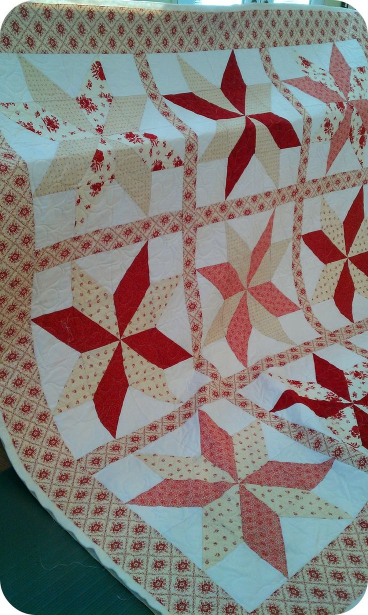 I like how the sashing breaks up the large white square that forms when the blocks are sewn together.