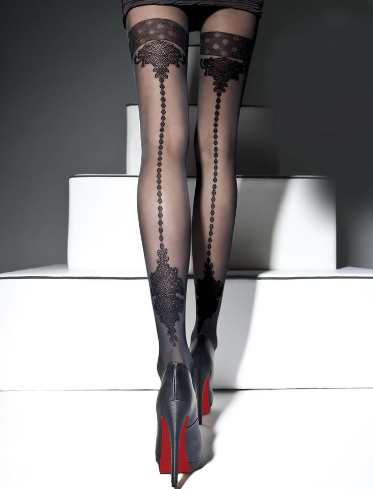 Ornate sheer tights with black pattern on back.