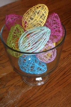 Embroidery floss easter eggs! All you need is balloons (regular or water balloons) blown up into an egg shape, liquid starch + flour, & embroidery floss. These look lovely hanging on a garland of embroidery floss (or fishing line!)