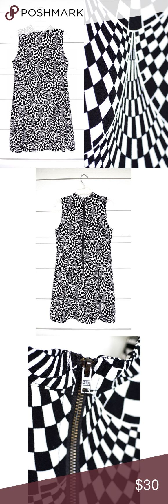 "Mod Sleeveless Mock Turtleneck Dress WORN ONCE ModCloth black and white optical-art patterned, mod style fitted dress w/ mock turtleneck collar and back zipper closure  Fitted bodice, pleated A-line skirt  39"" bust 32"" waist 35"" length Sunny Girl Dresses Mini"