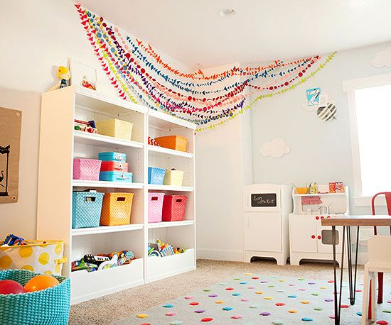 This colorful kids room is the perfect combination of wild and tame! Click here to browse more colorful, family-friendly styles: http://www.bhg.com/decorating/makeovers/6th-street-design-school-blog-house-tour/?socsrc=bhgpin010315creativecolorfulstorage&page=7