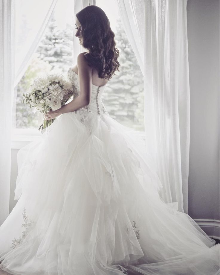 This beautiful wedding gown is made for a princess bride. Stunning corset top is straight out of a fairytale. #princess bride #weddingdress #corsetweddingdress #weddinggown
