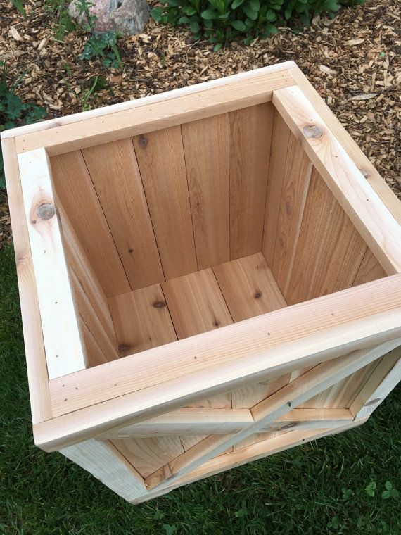 This listing is for 1 planter box. This planter would look great on your front porch, patio or garden area. It is made with cedar so it will last for years to come. You can plant directly in it or just drop already made flowers in it. It does have cedar feet on the bottom to help with