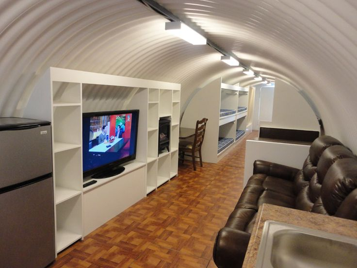 Atlas Survival Shelters complete with TV/DVD, reclining sofa, and flushing toilet.