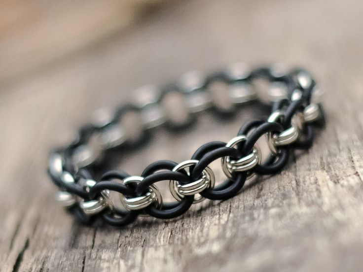 This gorgeous unisex bracelet looks awesome on a guy or girl! The think sterling wire and black jump rings make a classic design that goes with everything. MEMBER - Ahimsa Designs