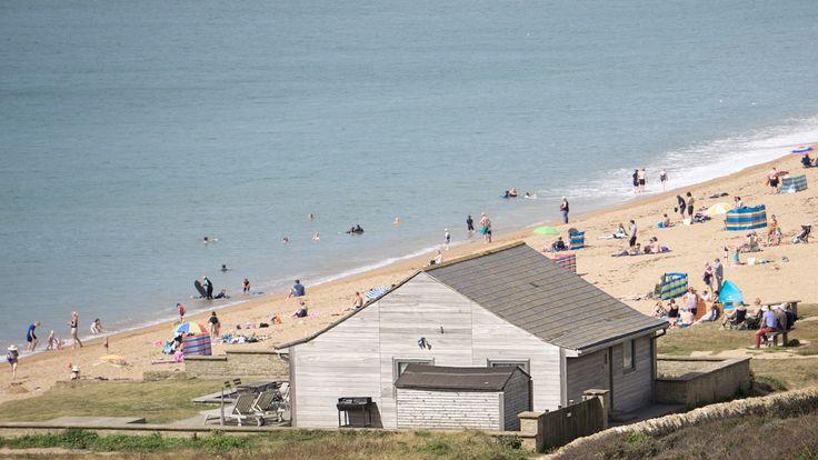 Grey house next to the beach at Golden Cap, Dorset, England