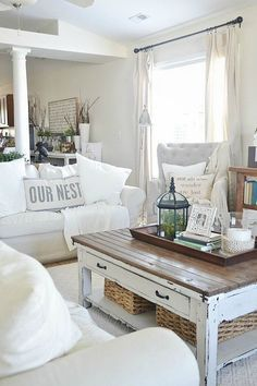 I like the decoration on the table -- I saw large cheap glass bowls with rope attached at Home Goodsthat I could put a big candle in and fill around. Surely I can find a shabby old-looking bird cage too -- could fill with decorative balls maybe? A fake plant inside like here would be cute too.