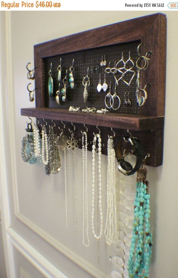 *****This is a MADE TO ORDER listing. You will receive a jewelry organizer the same as the one pictured above but this one already has a home.***** This listing is for a beautiful stained, wall mounted jewelry organizer just like the one pictured above. This is a smaller version of our jewelry shelves. It is the perfect size if you dont have lots of room but as you can see above there is still plenty of room for lots of jewelry. It is stained a beautiful dark cherry color. We left the…
