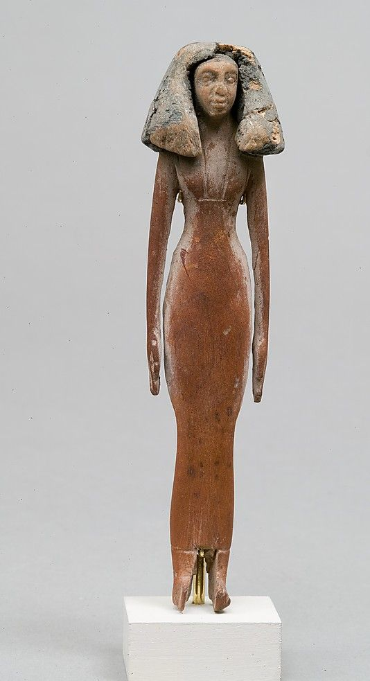 Statuette of woman Period: Middle Kingdom Dynasty: Dynasty 12–13 Date: ca. 1981–1640 B.C. Geography: Country of Origin Egypt, Memphite Region, Lisht North, west of pyramid of Amenemhat I, so-called Toilet Basket I without burial, MMA 1906–1907 Medium: Wood, paint