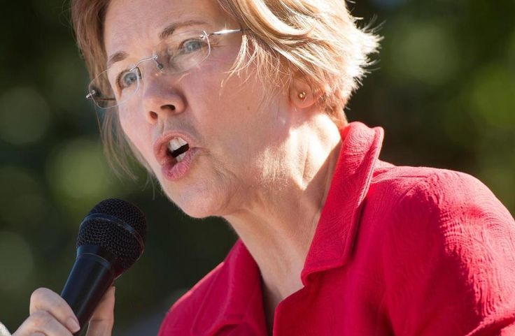 """US Senator Elizabeth Warren, Democrat from Massachusetts, speaks to demonstrators with Progressive Cities as they hold a protest to demand more recovery assistance for areas hit by recent hurricanes, including Puerto Rico from Hurricane Maria, during the """"March for Just Recovery,"""" on Capitol Hill in Washington, DC, on October 18, 2017. / AFP PHOTO / SAUL LOEBSAUL LOEB/AFP/Getty Images"""