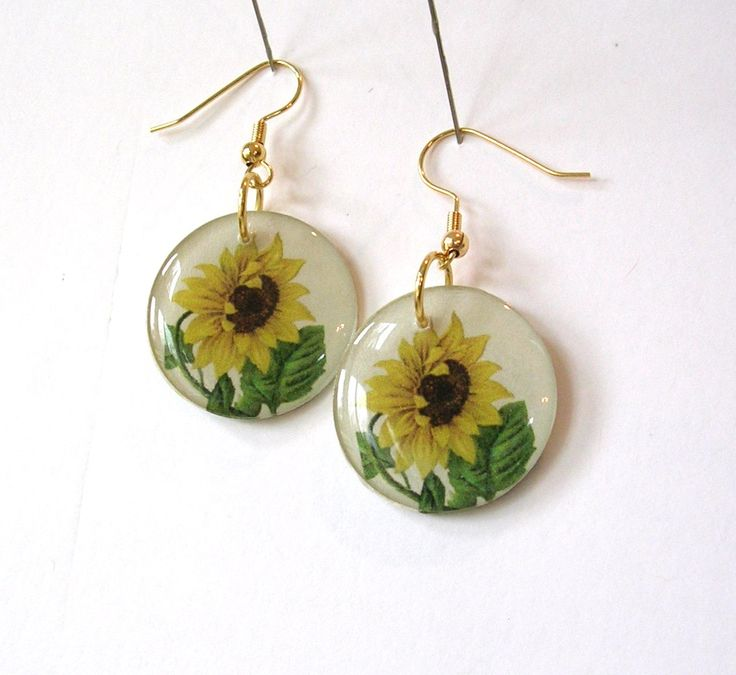 """A vintage sunflower image has been used to create these charming earrings. A great gift for any gardener or nature lover, the floral image is printed onto heavy archival paper and adhered to a 1"""" epoxy cap. The same image is decoupaged to the rear (see last photo for close-up)."""