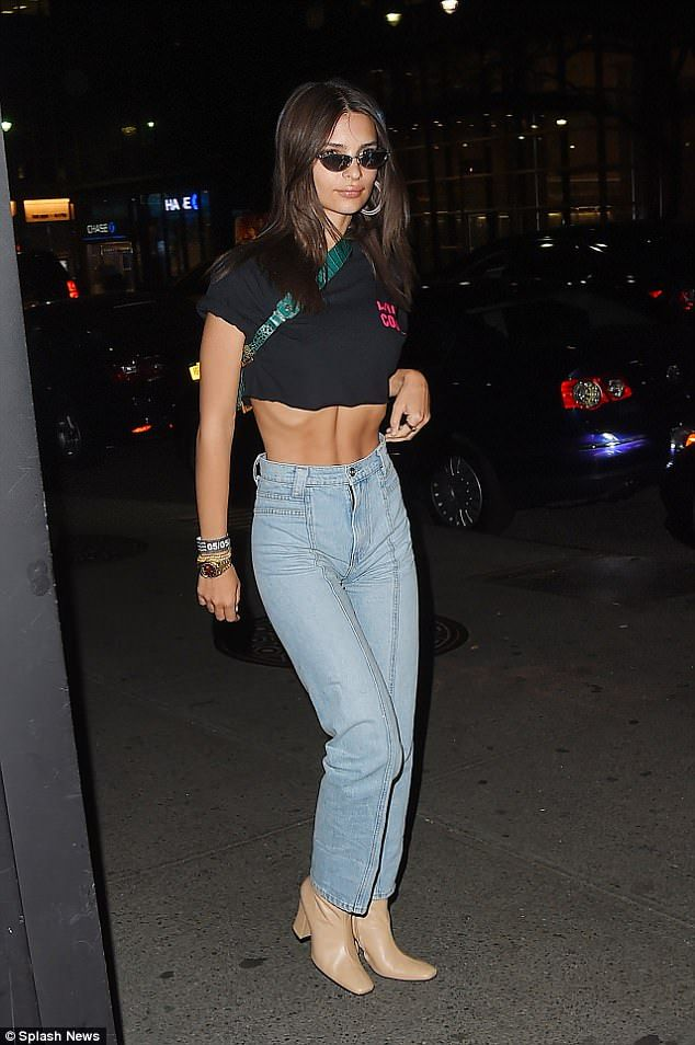 e0fea075fa4d Emulate Emily in a slogan crop top by LIVINCOOL. Click 'Visit' to buy now. # emilyratajkowski #DailyMail #livincool #offdutystyle