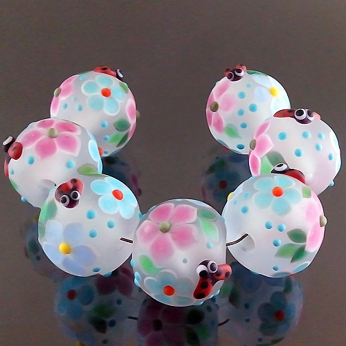 PIKALDA=handmade lampwork 7 glass beads flower blossom=LADYBUG IN BLUE=SRA