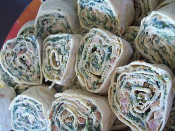 Spinach Pinwheels 20 ozs frozen chopped spinach (thawed drained  squeezed dry in paper towels) 8 ozs cream cheese, soften 1/2 cup mayo ? Tasty tip 1/2 cup sour cream 1 env ranch dip mix 1 jar bacon bits (or to taste) 4 green onions (chopped) 8 flour tortillas (count package 10-inch)