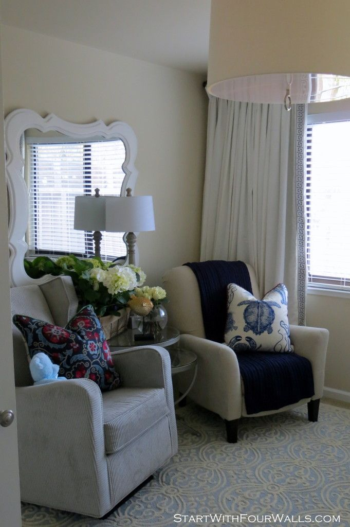 Love this seating area in the nursery - great modern accents in a classic room! #nursery