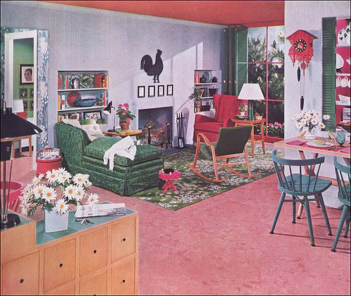 There is so many incredible things happening in this vintage pink, green and gray living room.