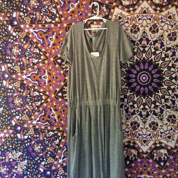 Free People Beach maxi dress Grey Free People maxi dress with pockets, a slit up the leg and a synched waist. Perfect for the beach or a summertime music festival. Free People Dresses Maxi