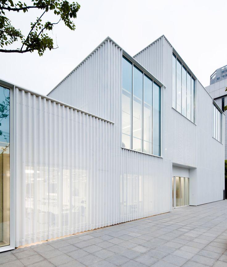 Schmidt Hammer Lassen Architects has transformed an ageing Shanghai office block into a business incubator, featuring a new translucent aluminium skin