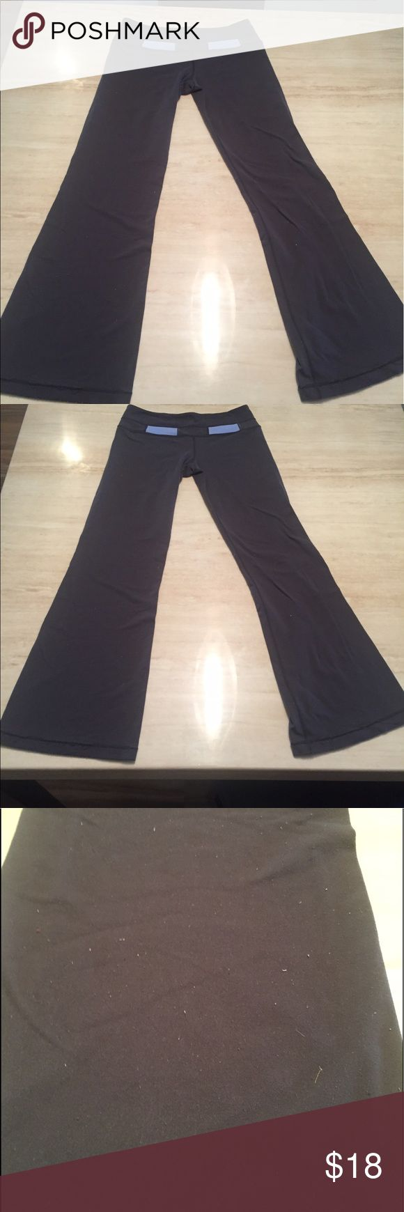 """Lululemon Gray / Baby Blue yoga Pants Adorable pair of Lululemon Gray with Baby Blue Reflector yoga pants. I could not find the size on these but I normally wear a medium in this brand. The waist stretches to 17.5"""" with a 32"""" inseam. These have been dry cleaned but these are made of the softest most clingy material, which is impossible to get the lent removed from. The hems are not coming apart but loose threads, as shown. There is much more life to these if you can overlook the lent. These…"""