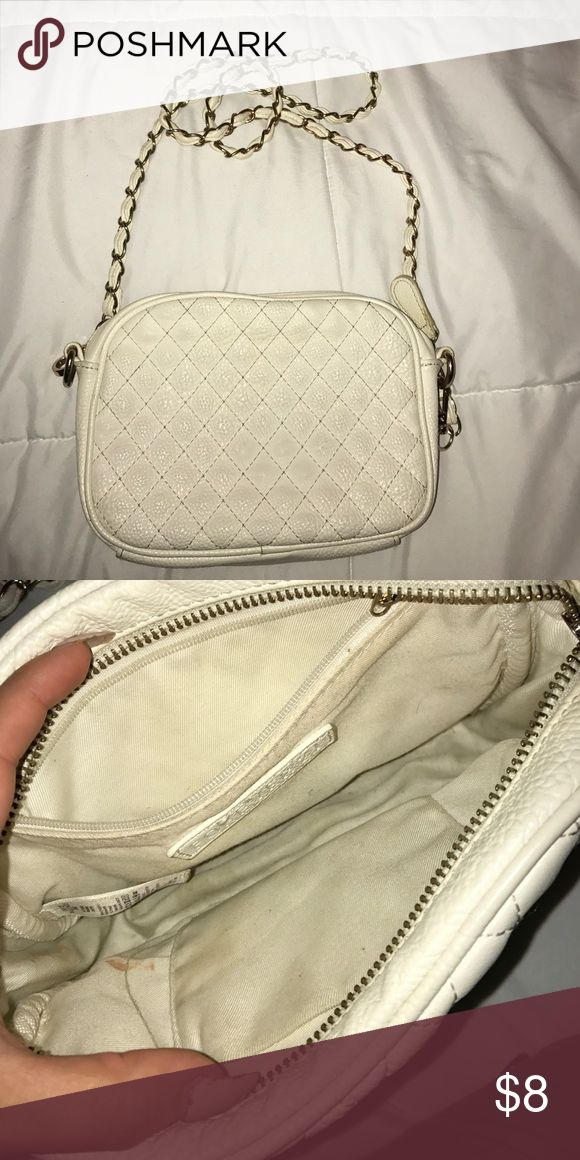 Forever 21 Shoulder Bag Off white/cream shoulder bag from Forever 21. Not as white as it was when new due to my jeans rubbing off on both sides. I'm sure it can be cleaned I just don't know how. Forever 21 Bags Shoulder Bags