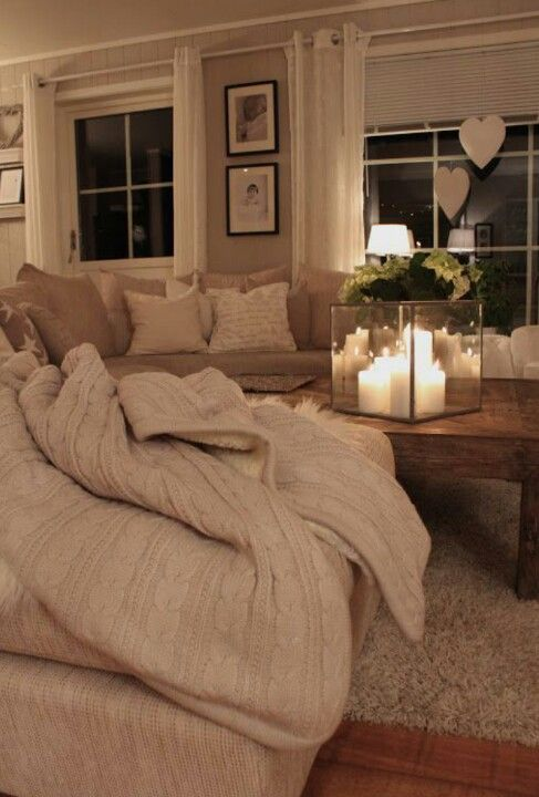 Nothing cosier than a sofa / throw / candle combination.