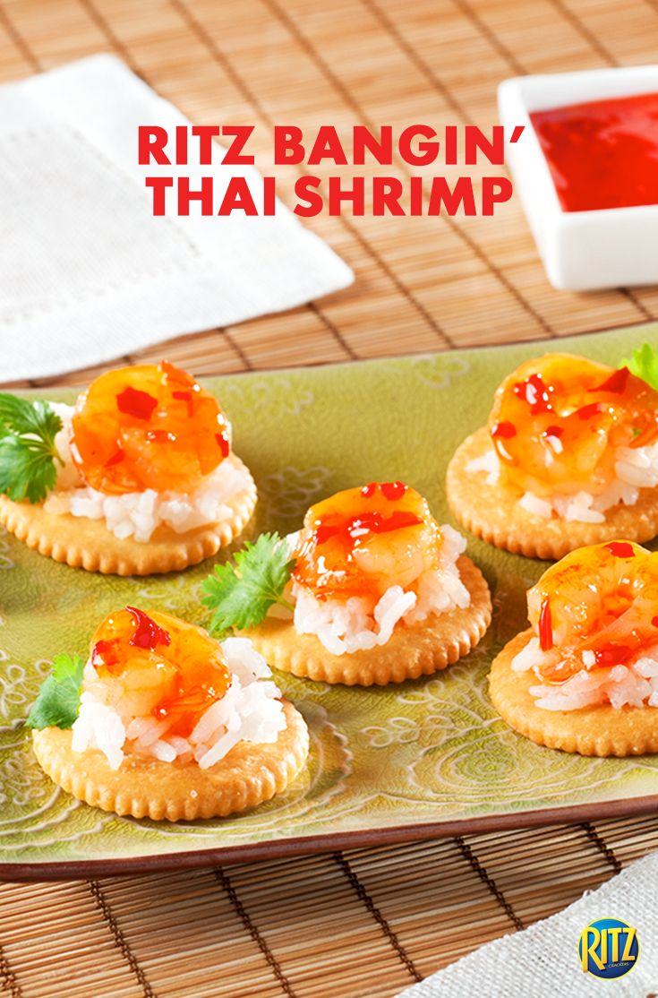 Buttery tasting RITZ crackers are a crunchy base for these RITZ Spicy Thai Shrimp party appetizers! Cook and stir shrimp in a skillet on medium-high heat for 2 to 3 min. Add chili sauce, cooking for another 30 seconds. Spoon white rice onto crackers and top with shrimp and zesty cilantro. Your #TeamSpicy snack spread just got even better!