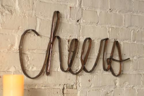Add a little merriment to any room with this scrap metal cheers!